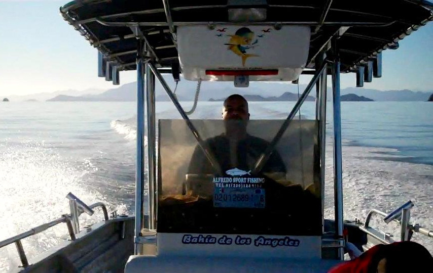 Robert Delgadillo commands a fishing boat back to shore on the Bahia de Los Angeles, Mexico in April 2013 to pack up the catch. (Photo by: Lazaro Quilon/fisherman)