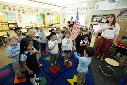 Children recite the Pledge of Allegiance on April 30, 2014 at Stafford Elementary School in Tacoma, Wash. Due to the No Child Left Behind Act, state school districts will lose their say in how approximately $40 million is used for education. (AP Photo/Ted Warren)